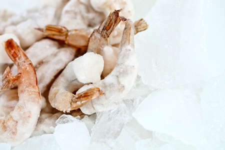 Bunch of frozen prawns on ice - seafood concepts  photo