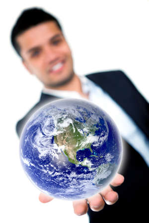 Businessman holding the earth - Global business concepts  photo