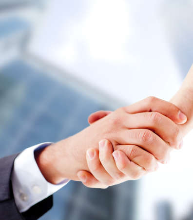 hired: Business handshake closing an important deal