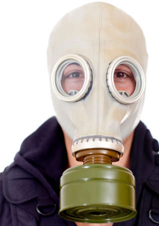Man wearing a gas mask on his face - isolated over a white background photo