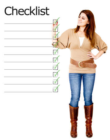 Woman ticking on a checklist - isolated over a white background  photo