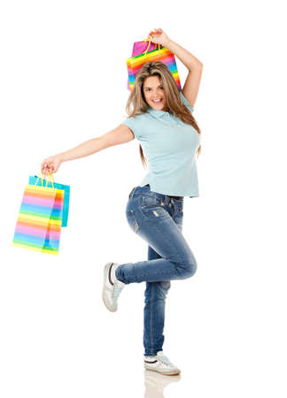 Happy shopping woman jumping isolated over white   photo