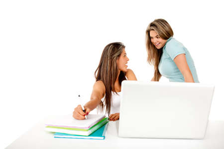 Happy female students with a laptop and notebooks � isolated  photo