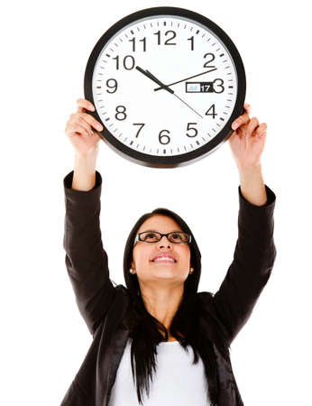 Business woman hanging a clock – isolated over a white background photo