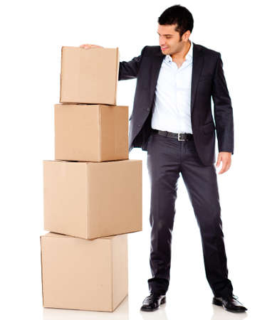 Businessman moving into a new office with boxes - isolated over white  photo