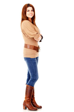 Casual woman stading - isolated over a white background  photo