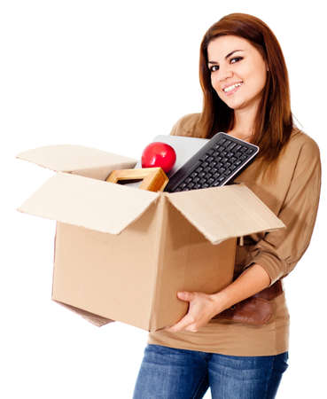 Woman moving house and holding a box - isolated over a white background  photo
