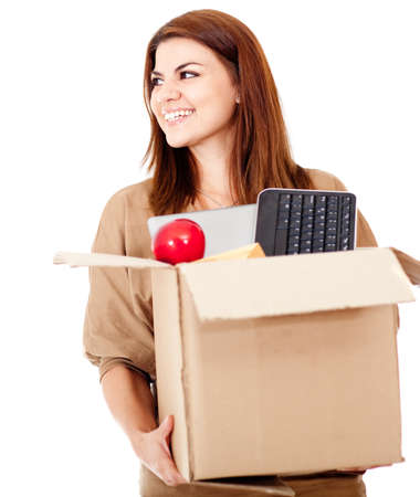 upgrading: Happy woman moving house and packing - isolated over white  Stock Photo
