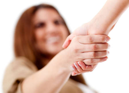 welcoming: Friendly handshake - isolated over a white background  Stock Photo
