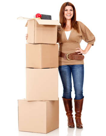 Happy woman moving house and packing in boxes - isolated over white  photo