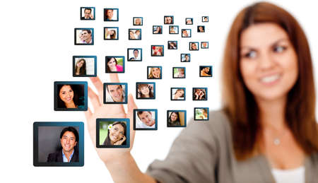 connecting: Woman with a social network - isolated over a white background  Stock Photo