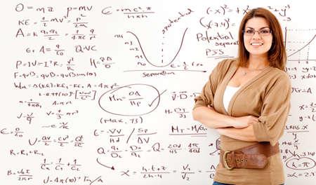 Math teacher with a board full of formulas  photo