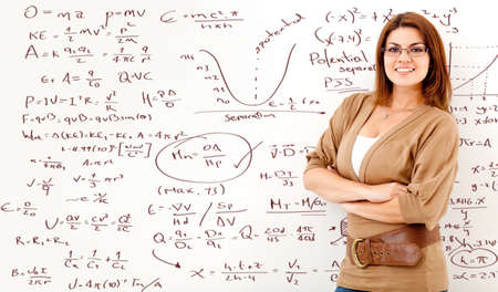 calculating: Math teacher with a board full of formulas