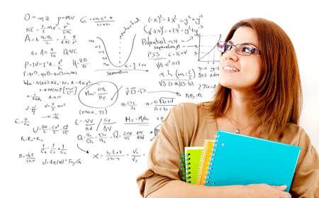 Female student studying maths thinking about formulas  photo