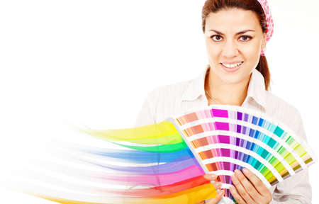 Female decorator holding a color guide and smiling  photo