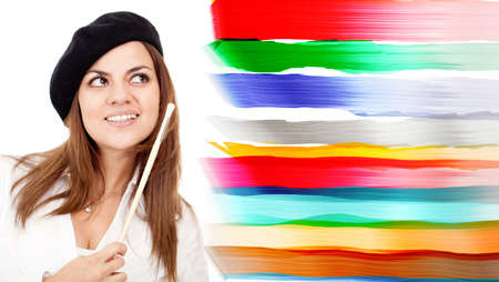 Female artist with a beret and brush - isolated over a white background  Stock Photo - 13649161
