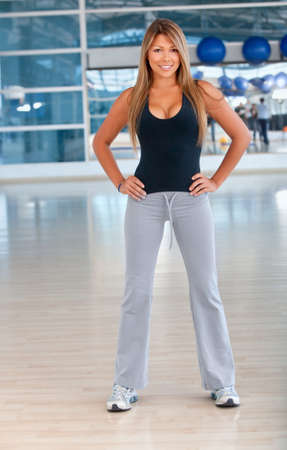 beautiful fit woman at the gym smiling photo