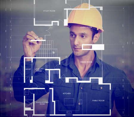 ingeniero civil: Trabajador de la construcci�n con un casco y planos bocetos