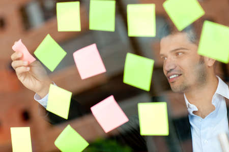 eventful: Multitask business man with lots of post-its