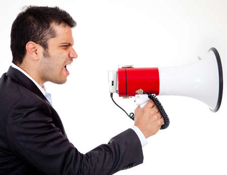 Businessman yelling through a megaphone - isolated over white  Stock Photo - 13648809