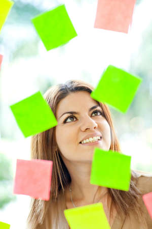 multitask: Multitask woman with post-its all around and smiling