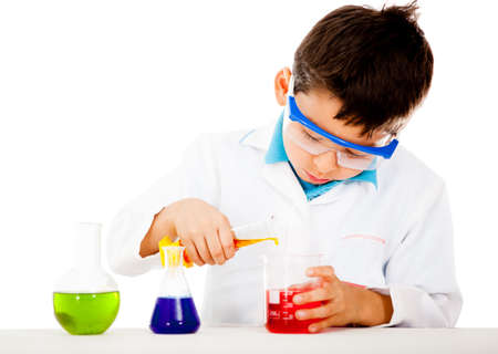 Boy at the lab making scientific experiments - isolated over white  Stock Photo - 13670537