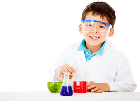 Little boy playing chemist - isolated over a white background  photo