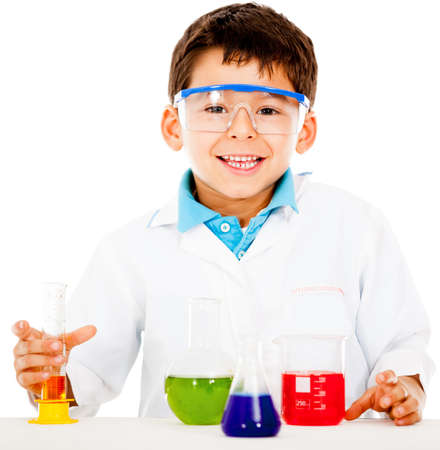 Boy making experiments at the laboratory - isolated over  white background  photo