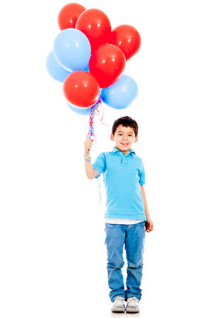 Boy holding colorful balloons - isolated over a white background  photo