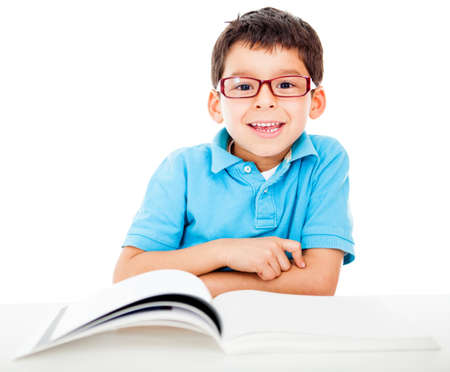 Geeky little boy studying and wearing glasses - isolated over a white background  photo