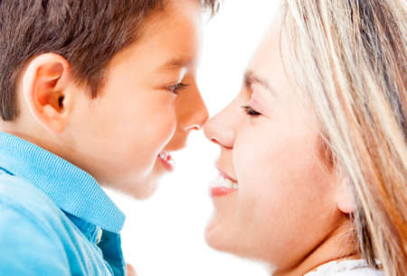 single moms: Portrait of a mother and son - isolated over a white background
