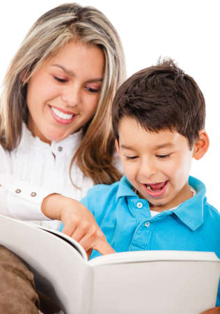 Happy mother and son reading a book - isolated over a white background photo