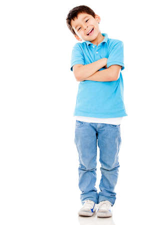 hispanic boy: Casual boy smiling standing isolated over a white background
