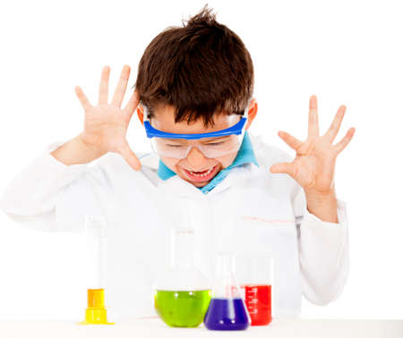 Boy doing chemical experiments at the lab - isolated over white  photo