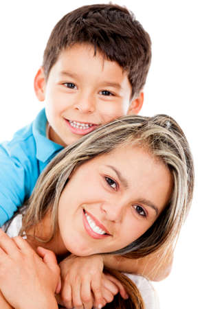 Happy boy with his mother smiling - isolated over a white background  photo