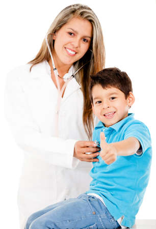Happy boy paying a visit to the doctor - isolated over a white background  photo