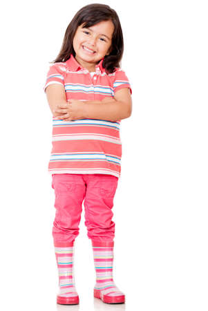 latin girl: Confident little girl with arms crossed - isolated over a white background
