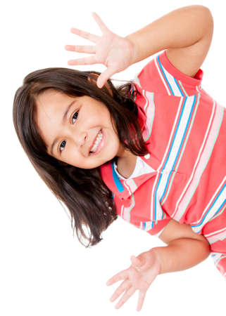 cute little girls: Little girl having fun and smiling - isolated over a white background  Stock Photo