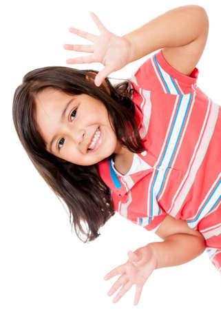 jolie petite fille: Petite fille en s'amusant et souriant - isol� sur un fond blanc