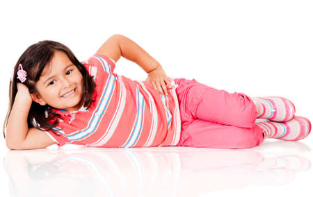 Cute girl lying on the floor - isolated over a white background photo