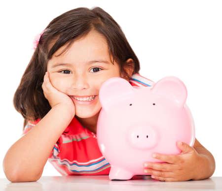 pieniądze: MaÅ'a dziewczynka oszczÄ™dzania pieniÄ™dzy w piggybank - izolowanych ponad biaÅ'ym tle Zdjęcie Seryjne