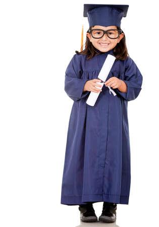 graduacion ni�os: Chica se gradu� con un vestido de graduaci�n - aislados en un fondo blanco Foto de archivo