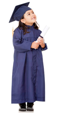 Pensive graduate girl - isolated over a white background  photo