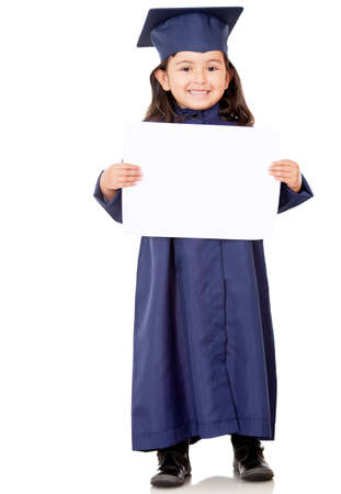 Little girl graduating and holding diploma – isolated over white photo