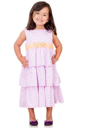 jolie petite fille: Jolie fille v�tue d'une robe magnifique - isol� sur un fond blanc