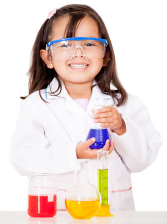 Girl doing chemical experiments at the lab - isolated over white photo