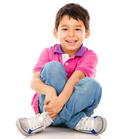 sitting on floor: Happy little boy - isolated over a white backgorund  Stock Photo