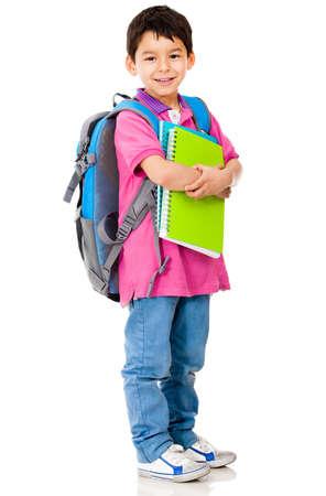 hispanic student: Joven estudiante de preescolar de llevar mochila y cuadernos - aislados en blanco