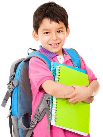 escuela primaria: Estudiante de la escuela primaria de llevar cuadernos - aislados en un fondo blanco