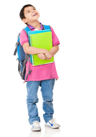 Pensive boy student carrying notebooks - isolated over a white background  photo